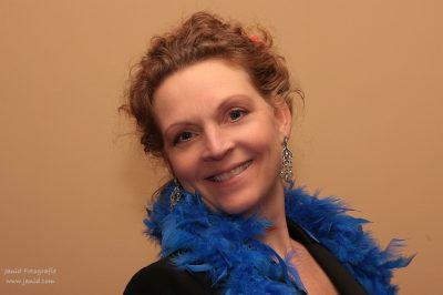 Esther van Dijk, dirigente Homomannenkoor Zangzaad